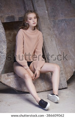 Young woman in shorts and cream pullover. - stock photo
