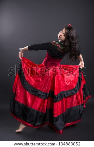 Young woman in spanish traditional clothes in studio