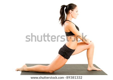 young woman in sports bra on yoga pose on isolated white background - stock photo