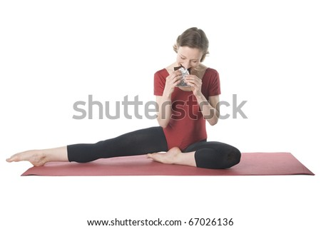 Young woman in sports clothes eating chocolate