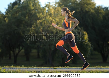 young woman in sportswear jogging - stock photo