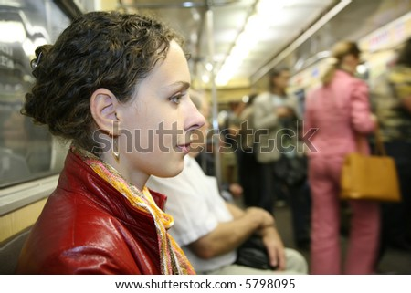 young woman in subway - stock photo