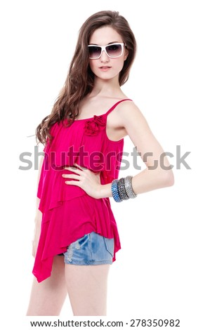 Young woman in sunglass with bag in studio - stock photo