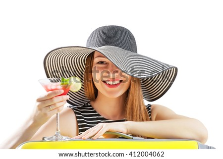 young woman in sunhat drinks cocktial - stock photo
