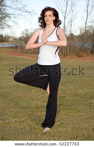 Young woman in Tadasana (Tree pose)