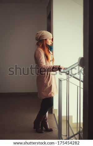 Young woman in the apartment building - stock photo