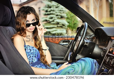 Young woman in the car  - stock photo