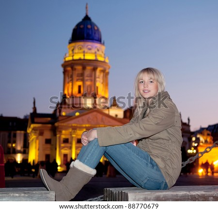 young woman in the city at evening - stock photo
