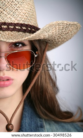 young woman in the cowgirl image - stock photo