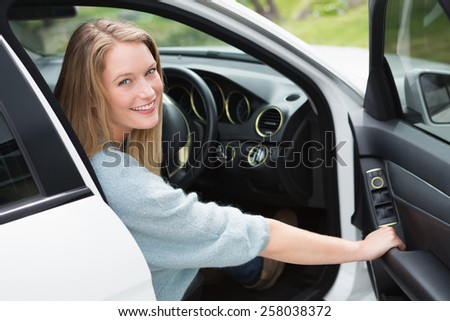 Young woman in the drivers seat in her car - stock photo