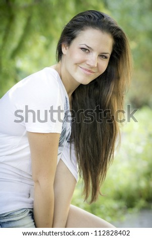Young woman in the forest on a sunny day