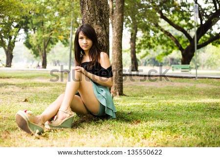 Young woman in the green park