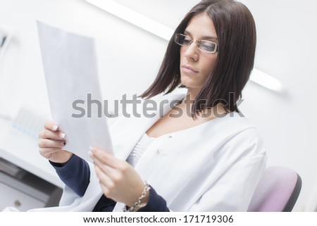 Young woman in the medical laboratory - stock photo
