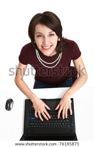 young woman in the office sitting at the table, in front of the notebook, on white background - stock photo
