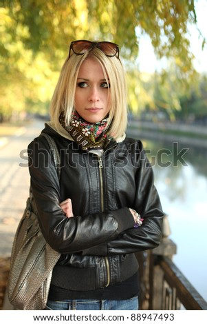 Young woman in the park, autumn - stock photo