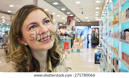 Young woman in the perfumery - stock photo