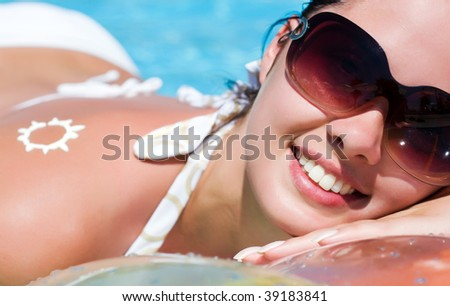 Young woman in the pool - stock photo