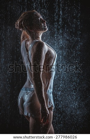 young woman in the rain - stock photo