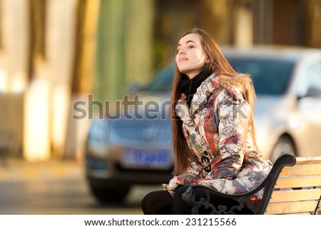 Young woman in the rays of the spring sun - stock photo