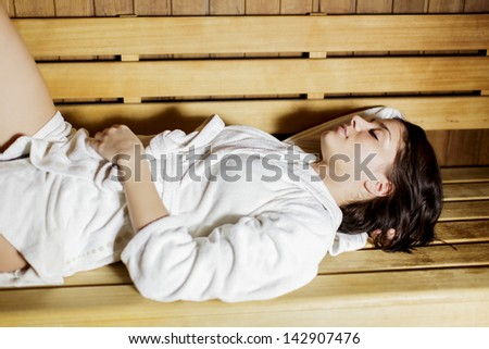 Young woman in the sauna