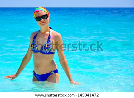 Young woman in the sea - stock photo