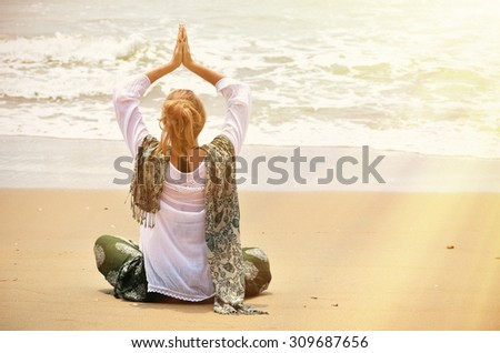 Young woman in the traditional punjabi dress on Patnam beach. South Goa, India - stock photo