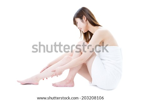 young woman in towel, isolated on white background