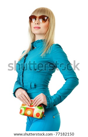 Young woman in turquoise dress posing over white background - stock photo