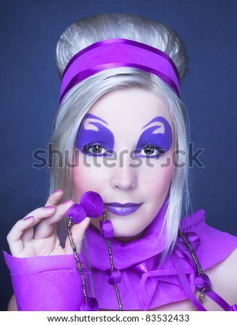 Young woman in violet with artistic visage and with retro hairstyle