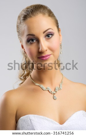 Young woman in wedding dress isolated