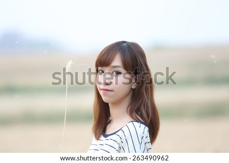 Young woman in wheat - stock photo