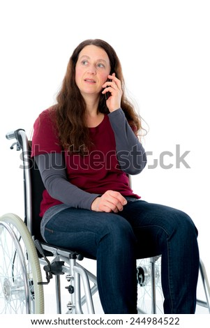 young woman in wheelchair calling with cellphone