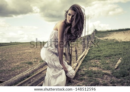 Young woman in white dress outdoor  - stock photo