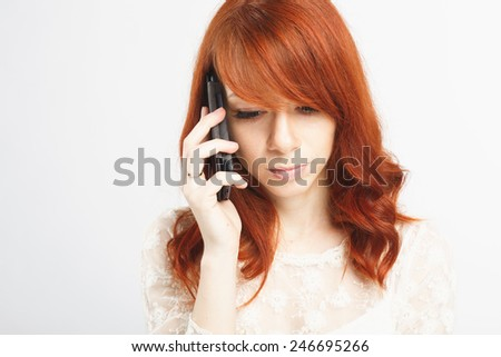 young woman in white dress talking on the phone. White background - stock photo