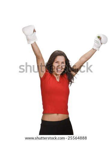 Young woman in white kickboxing gloves celebrating the victory.