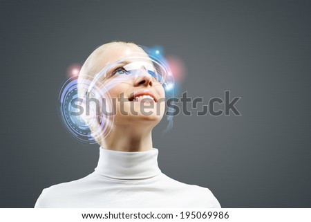 Young woman in white with hologram round head - stock photo