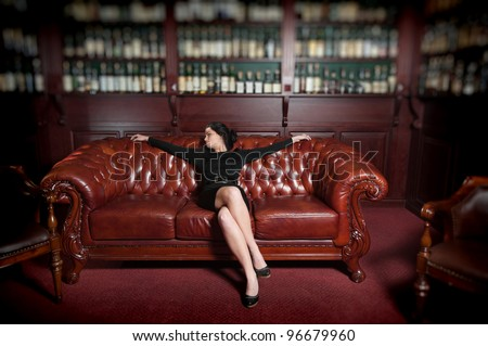 Young woman in wine library - stock photo