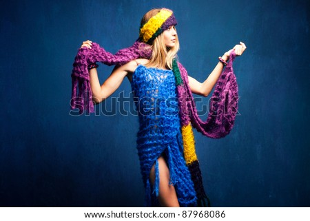 young woman in wool scarfs, studio shot - stock photo