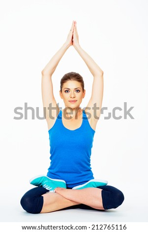 young woman in yoga lotus  pose sitting on a floor . white background isolated . - stock photo