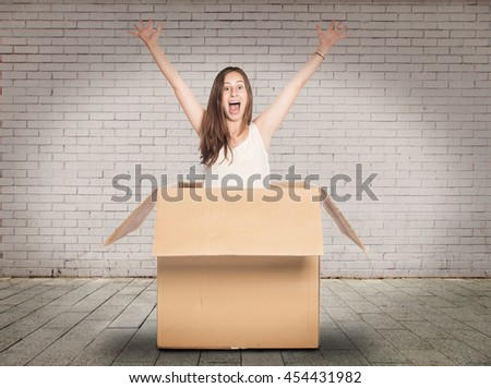 young woman inside a Box in a room