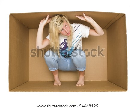 Young woman inside a Cardboard Box isolated on white