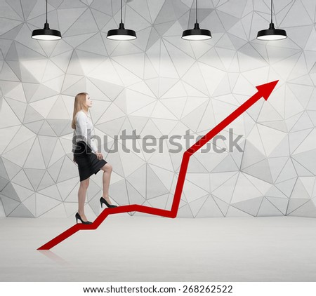 Young woman is climbing up - stock photo