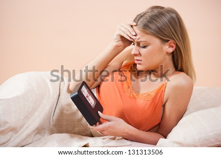 Young woman is disappointed because she has to get up early,Waking up - stock photo