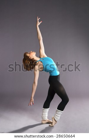 Young woman is doing exercise.