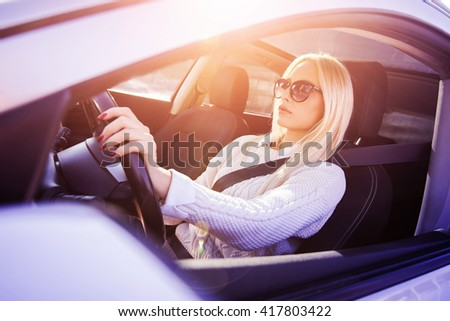 Young woman is drawing her car - stock photo