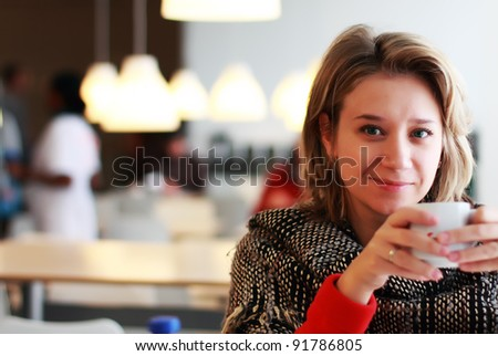 young woman is drinking coffee - stock photo