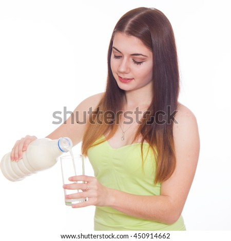 Young woman is drinking milk