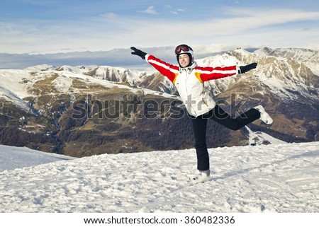young woman is enjoying winter sport