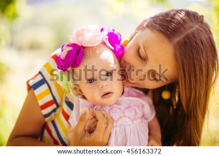 young woman  is happy with her  wonderful  little baby