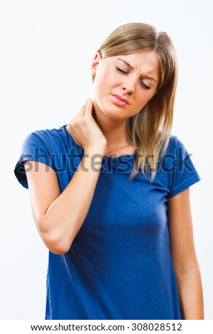Young woman is having neck pain.Neck pain - stock photo